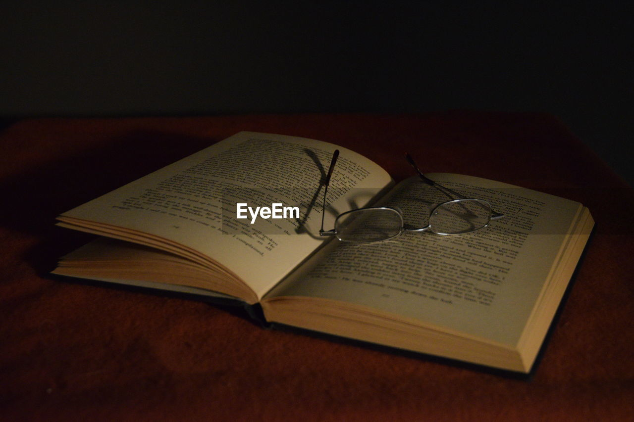book, open, page, education, table, still life, knowledge, religion, diary, indoors, text, communication, no people, paper, spirituality, literature, learning, wisdom, eyeglasses, close-up