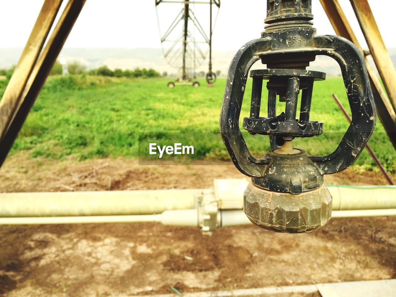 metal, day, no people, wheel, focus on foreground, close-up, outdoors, pipe - tube, valve, irrigation equipment