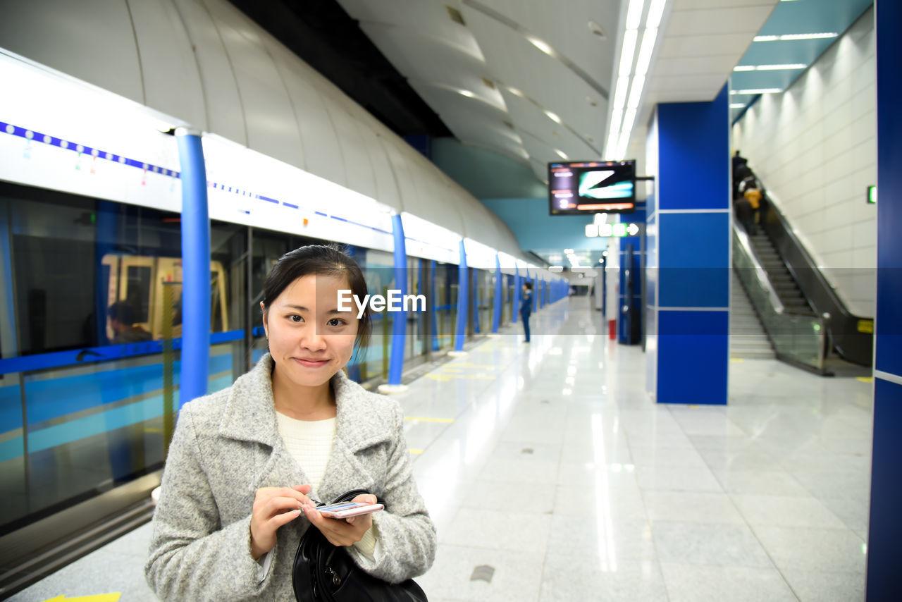 Portrait Of Woman On Railroad Station Platform