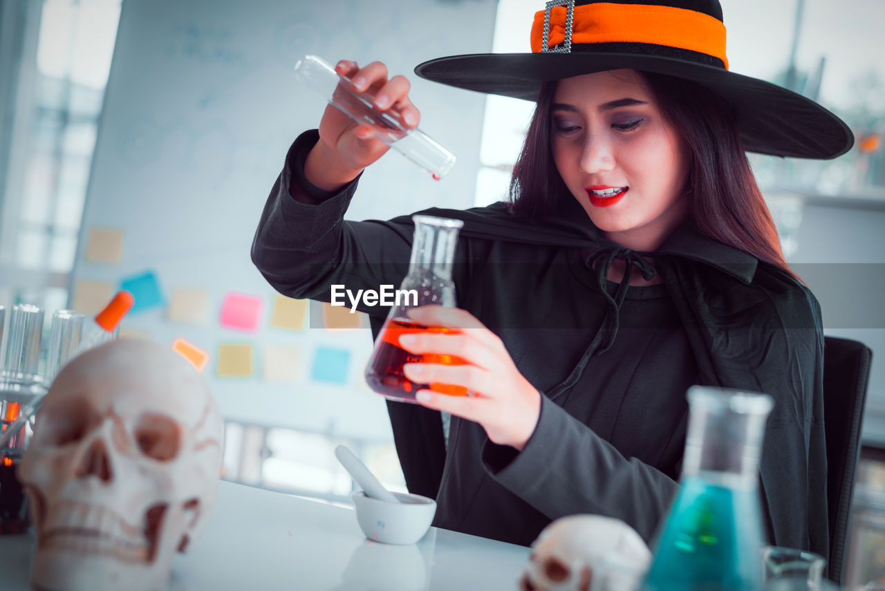 real people, one person, drink, food and drink, holding, young women, young adult, women, front view, table, refreshment, indoors, lifestyles, leisure activity, adult, portrait, waist up, sitting, glass