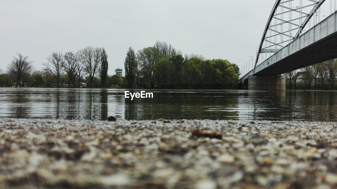 water, bridge, sky, connection, architecture, built structure, bridge - man made structure, nature, tree, river, plant, no people, reflection, day, selective focus, transportation, waterfront, tranquility, outdoors, surface level