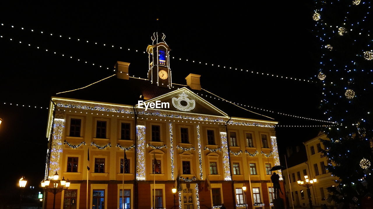 building exterior, architecture, built structure, night, illuminated, low angle view, no people, christmas decoration, outdoors, christmas lights, city, sky