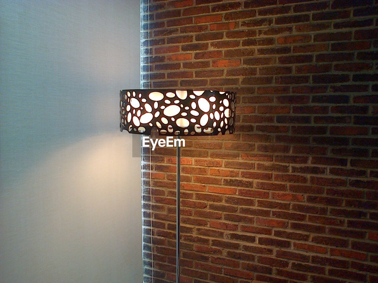 wall - building feature, brick wall, illuminated, lighting equipment, no people, indoors, electricity, architecture, built structure, close-up, day