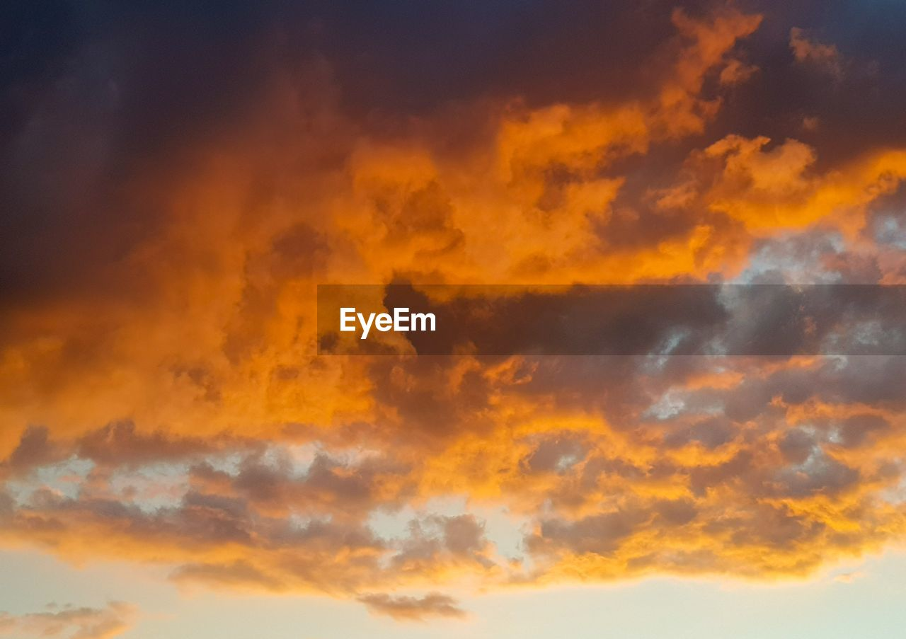 sky, cloud - sky, sunset, beauty in nature, orange color, scenics - nature, tranquility, tranquil scene, low angle view, nature, idyllic, no people, dramatic sky, backgrounds, outdoors, cloudscape, full frame, majestic, non-urban scene, meteorology