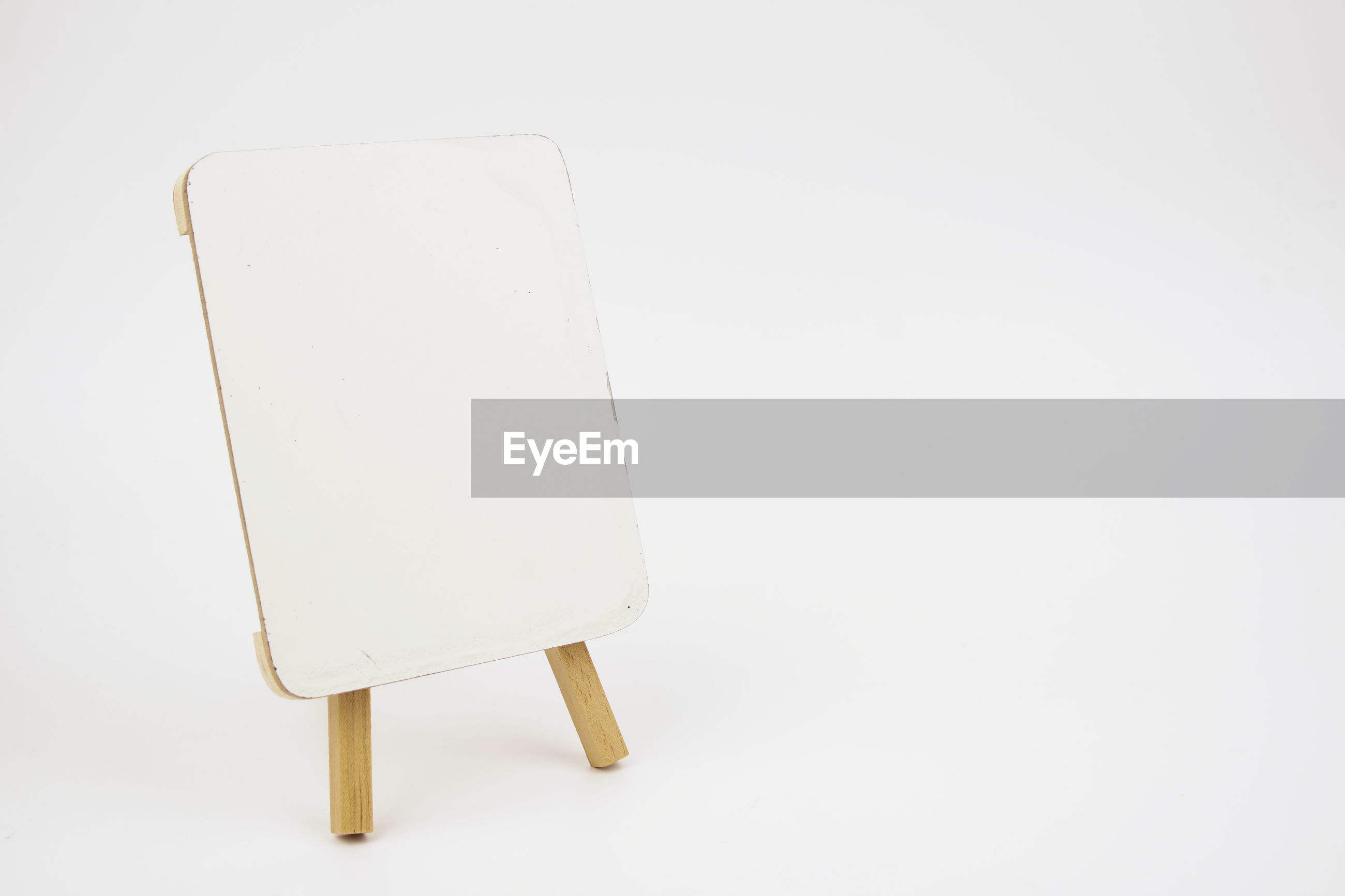 Close-up of easel against white background