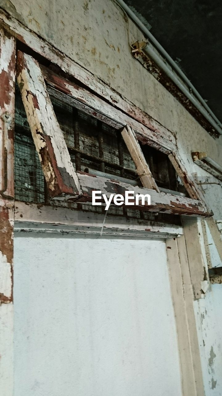 architecture, damaged, weathered, no people, building exterior, abandoned, built structure, window, rusty, day, low angle view, outdoors, rotting, close-up
