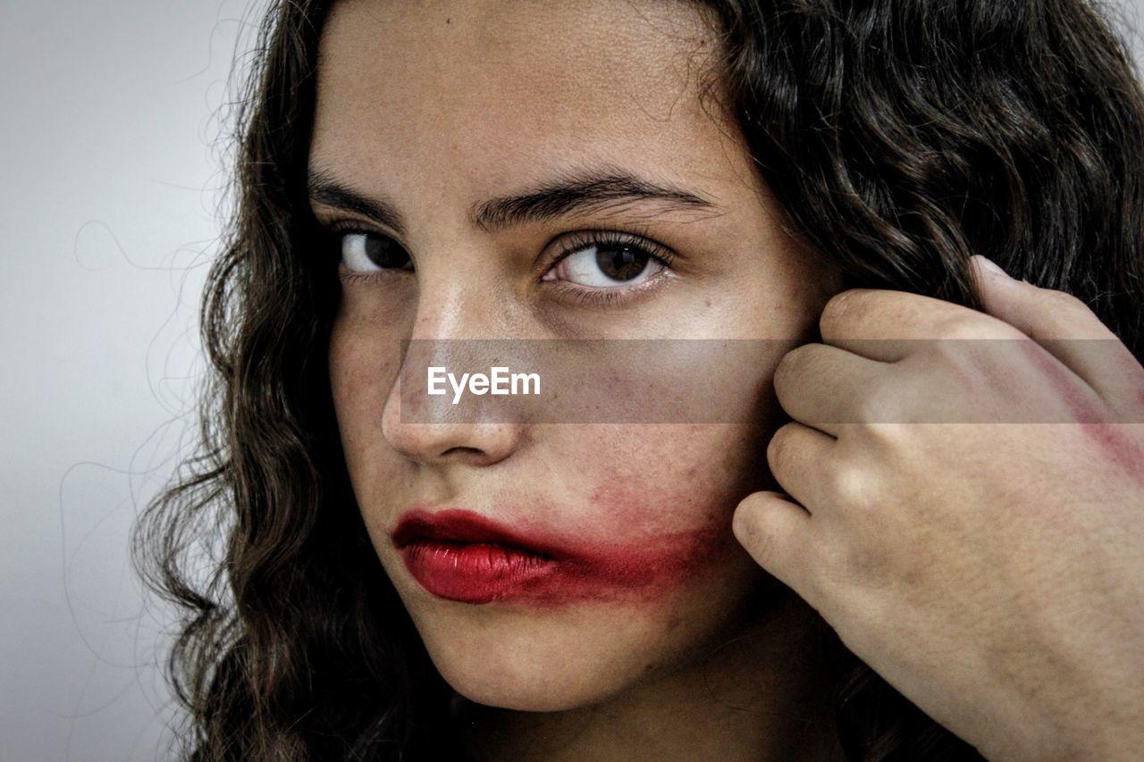 Close-up of young woman looking at camera