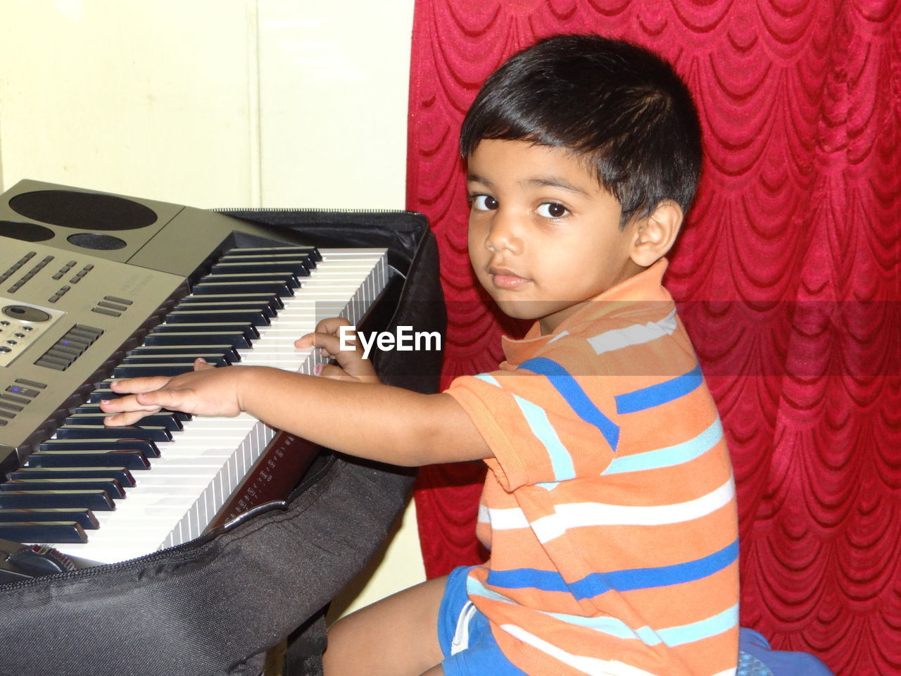 Portrait of boy playing piano