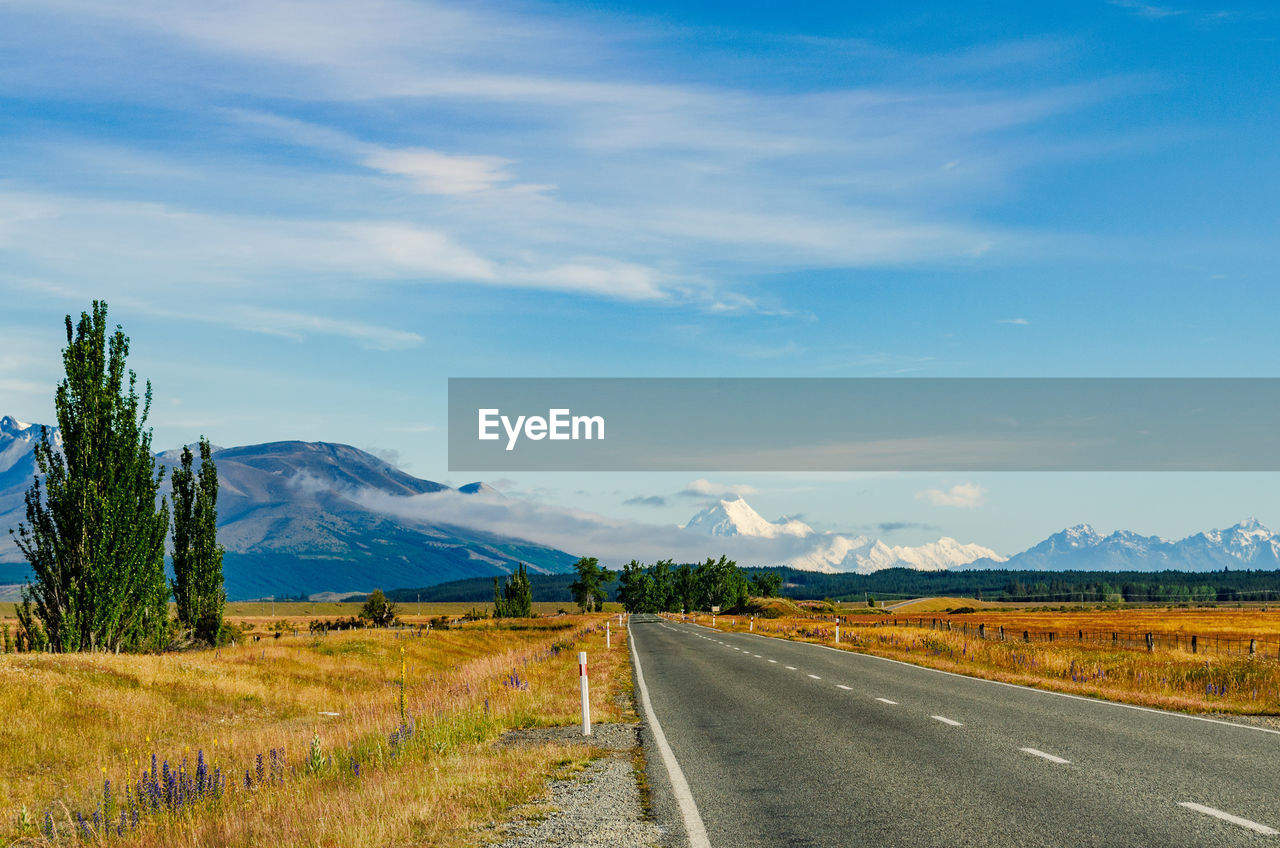 sky, road, cloud - sky, direction, the way forward, transportation, mountain, beauty in nature, landscape, environment, tranquility, scenics - nature, tranquil scene, non-urban scene, no people, nature, plant, day, land, mountain range, outdoors, diminishing perspective, long, dividing line