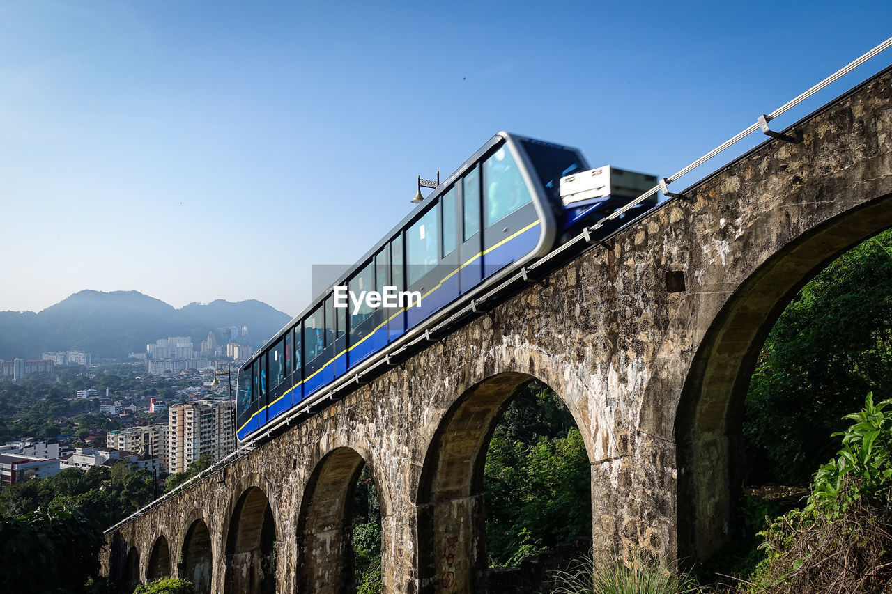 Low Angle View Of Tram On Arch Bridge Against Clear Sky