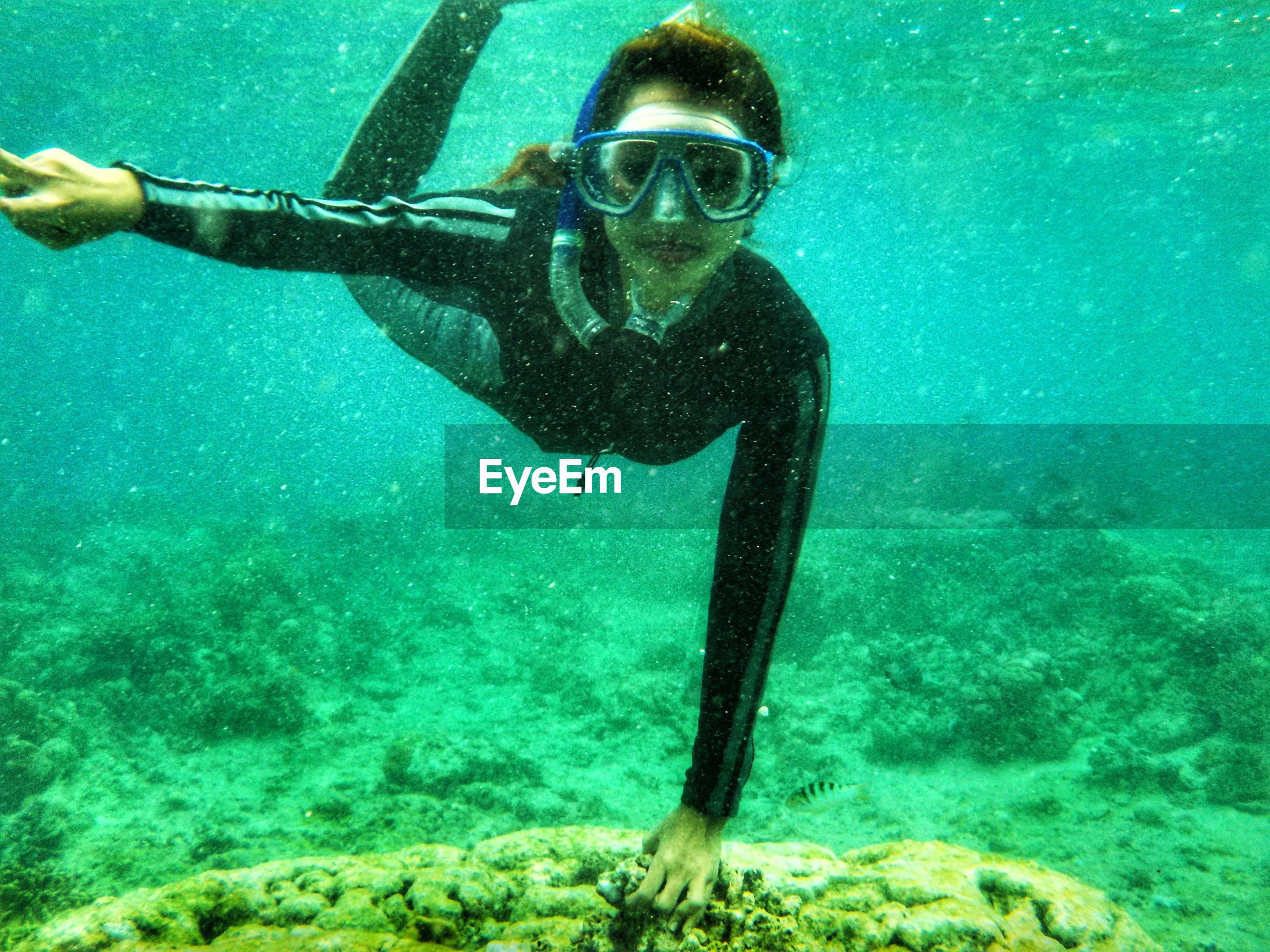 underwater, undersea, sea, water, swimming, adventure, swimming goggles, scuba diving, scuba mask, one person, looking at camera, snorkeling, leisure activity, portrait, lifestyles, real people, sea life, nature, day, outdoors, young adult, scuba diver, close-up, people, adult