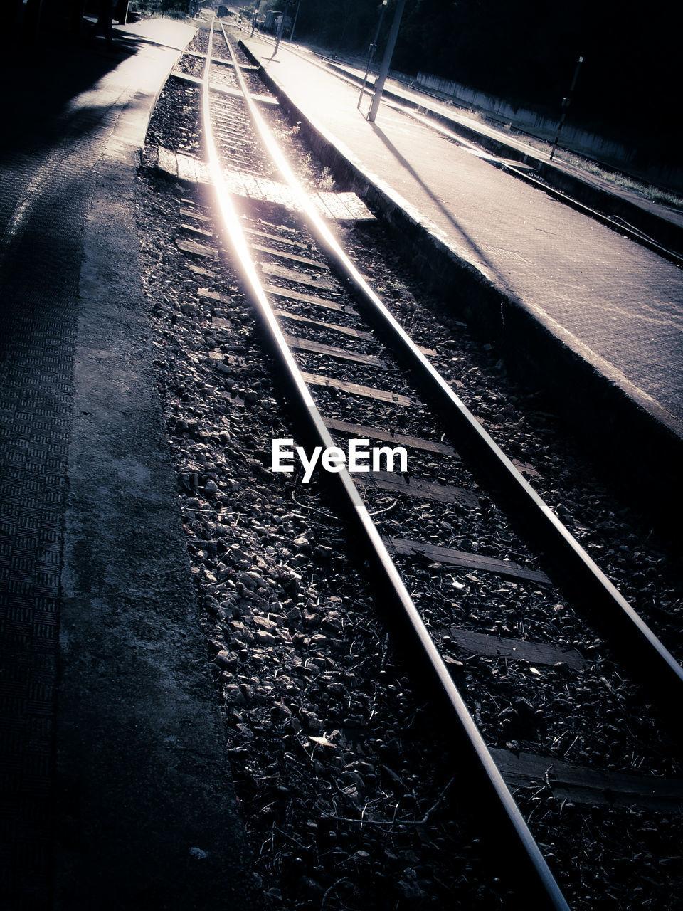 transportation, railroad track, rail transportation, night, no people, public transportation, illuminated, outdoors