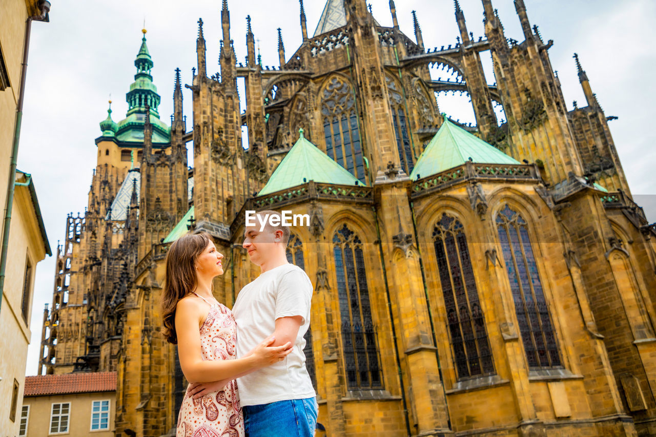 building exterior, architecture, built structure, two people, young women, place of worship, togetherness, women, religion, young adult, adult, young men, couple - relationship, building, travel, low angle view, belief, travel destinations, hair, positive emotion