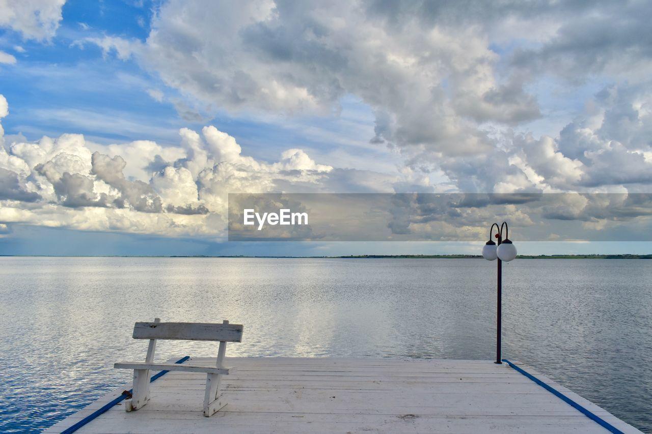 cloud - sky, sky, water, beauty in nature, sea, scenics - nature, nature, seat, day, tranquil scene, tranquility, horizon over water, idyllic, horizon, bench, non-urban scene, outdoors, no people