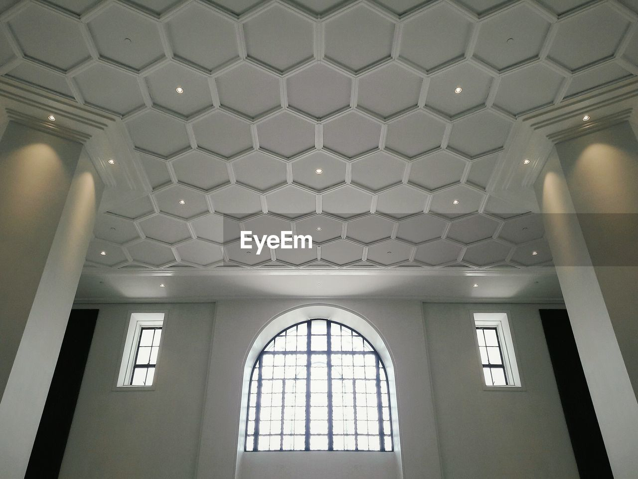 ceiling, indoors, no people, architecture, window, low angle view, arch, built structure, illuminated, day