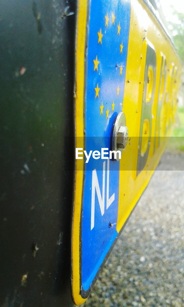 outdoors, day, yellow, communication, metal, blue, no people, close-up, road