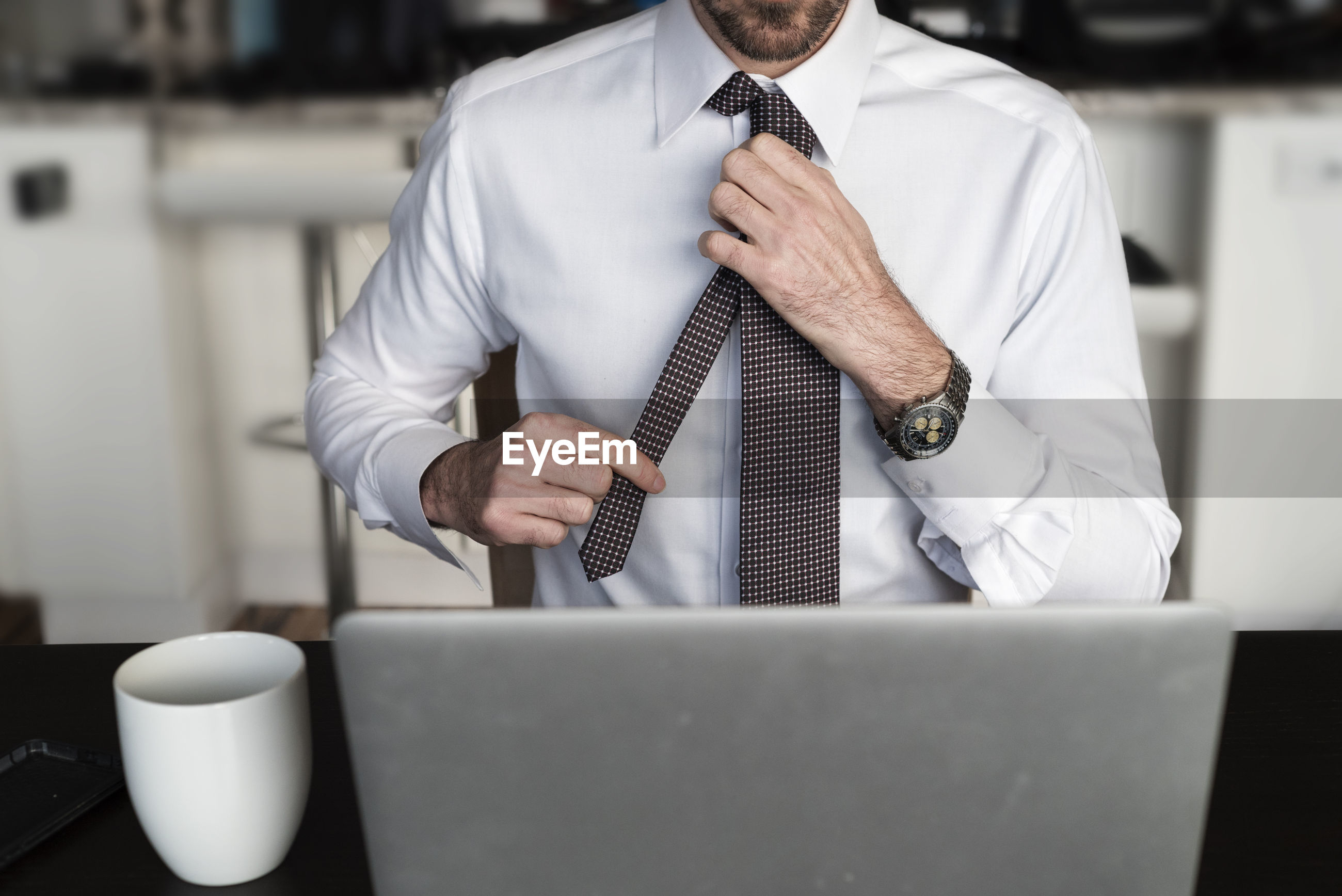 Midsection of man working in office