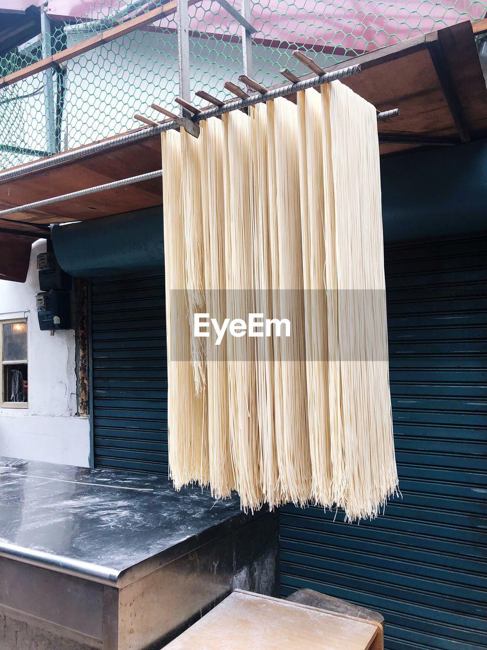 Noodles hanging on rod