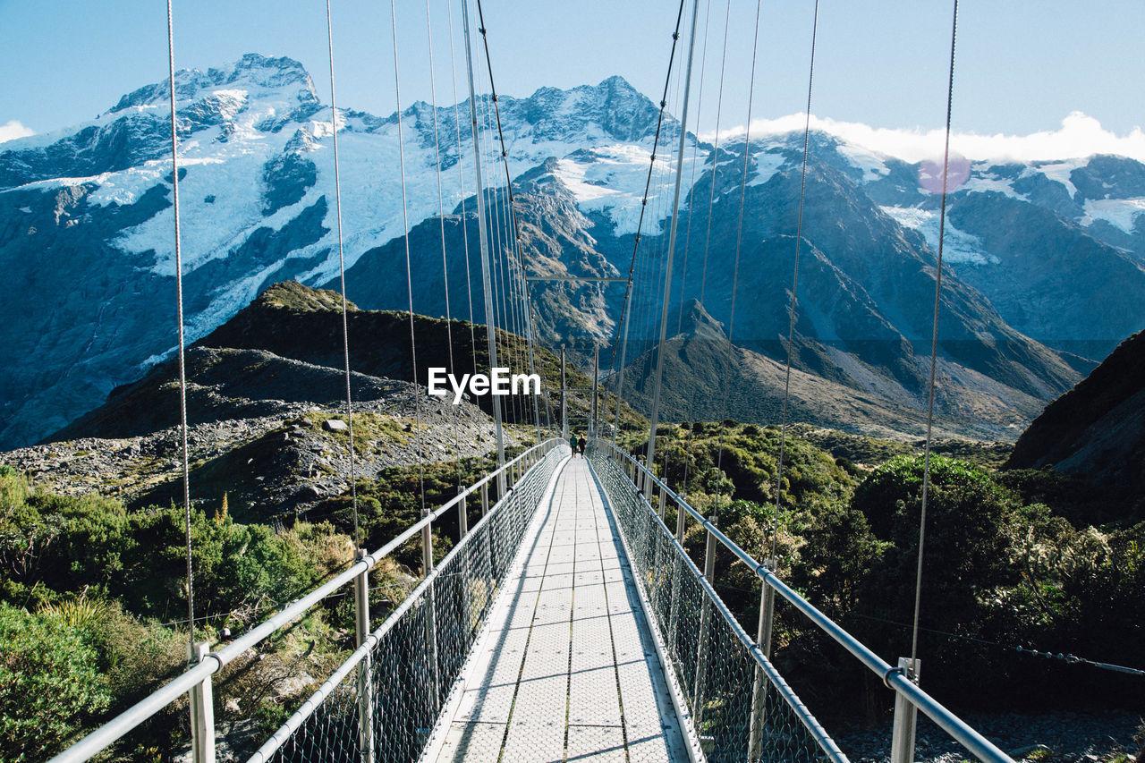 Suspension Bridge Against Mount Cook At Hooker Valley Track