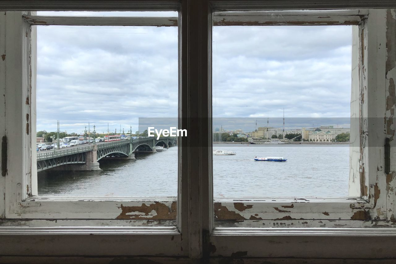 water, cloud - sky, sky, window, transportation, nautical vessel, architecture, built structure, mode of transportation, nature, no people, bridge, day, city, river, bridge - man made structure, connection, indoors