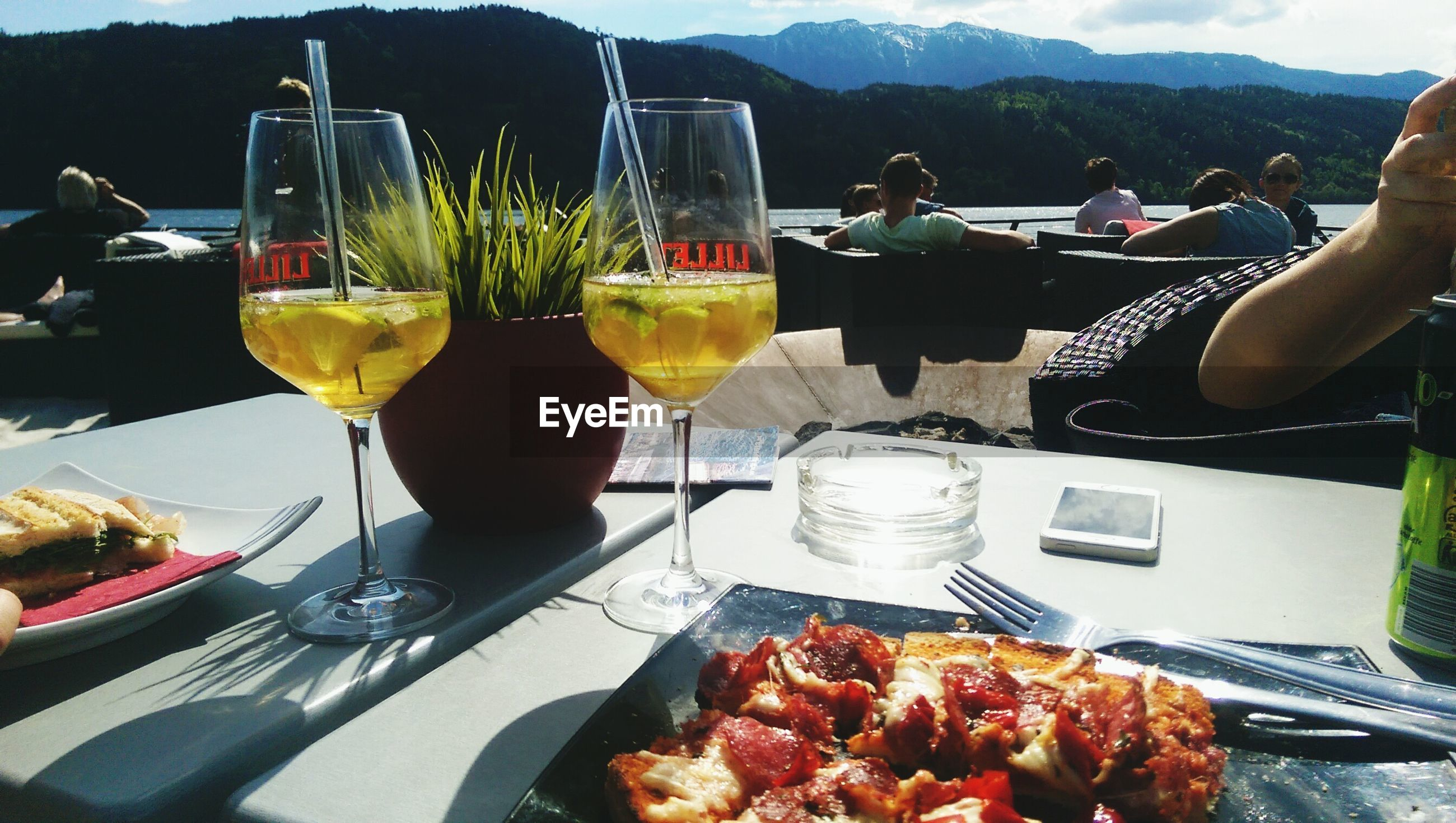 food and drink, food, freshness, drink, drinking glass, table, plate, ready-to-eat, refreshment, healthy eating, restaurant, serving size, wineglass, still life, juice, indoors, fruit, incidental people, salad, slice