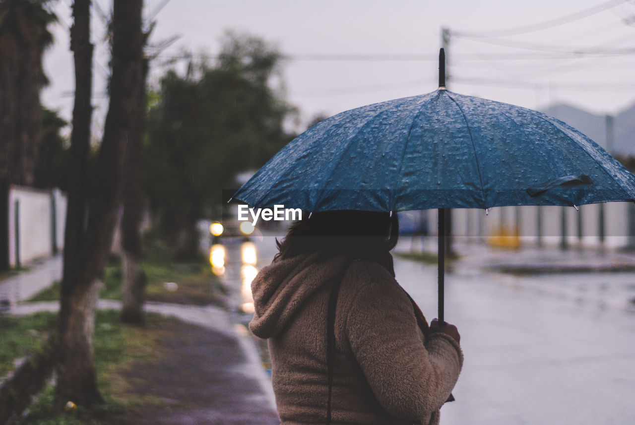 Woman with umbrella on street