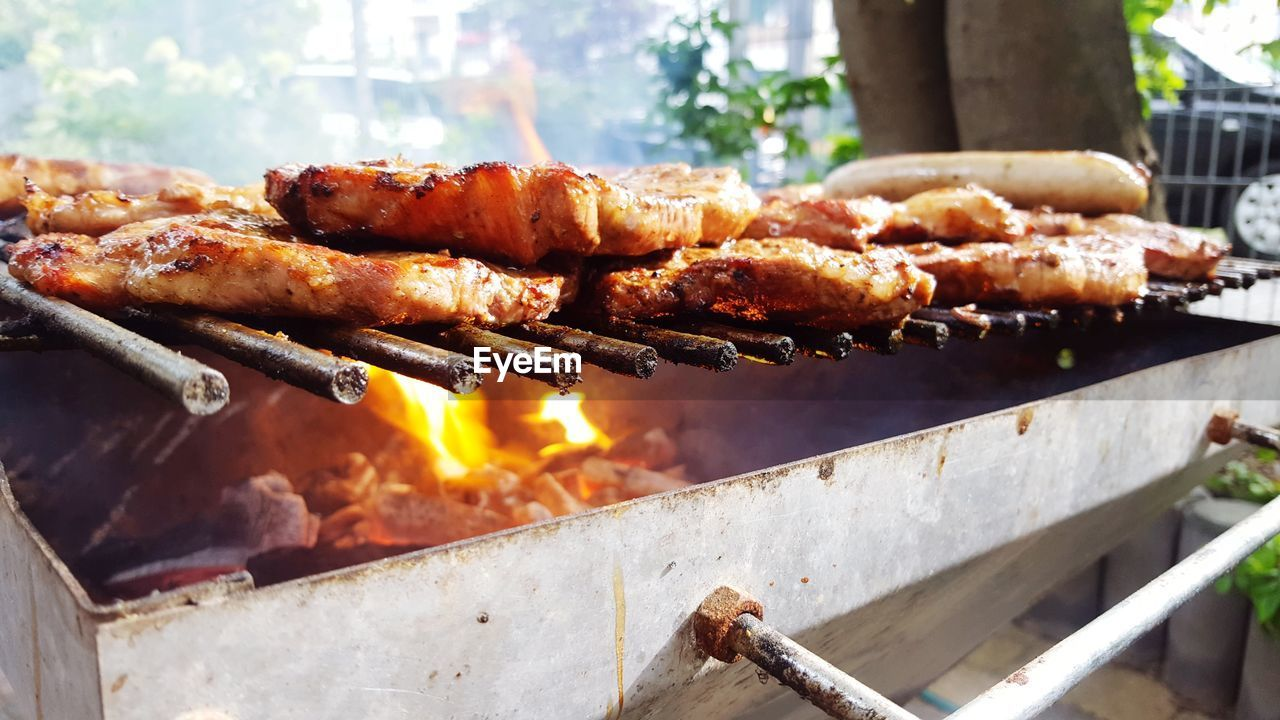 barbecue, barbecue grill, grilled, heat - temperature, food, food and drink, flame, meat, burning, outdoors, skewer, grilled chicken, preparation, no people, freshness, day, close-up, chicken wing, ready-to-eat