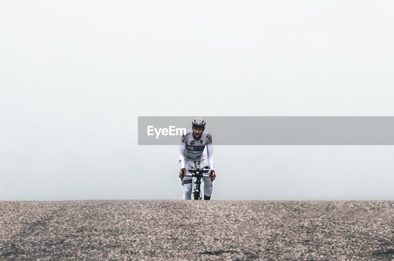 copy space, one person, full length, land, real people, nature, standing, day, field, sky, men, environment, rear view, leisure activity, casual clothing, lifestyles, landscape, unrecognizable person, obscured face, warm clothing