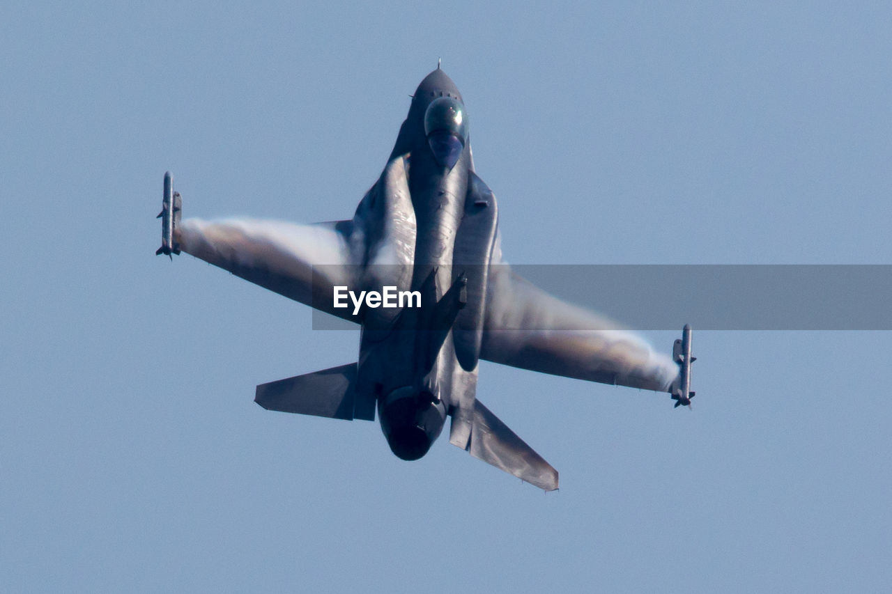 Fighting Falcon Flying Against Clear Blue Sky