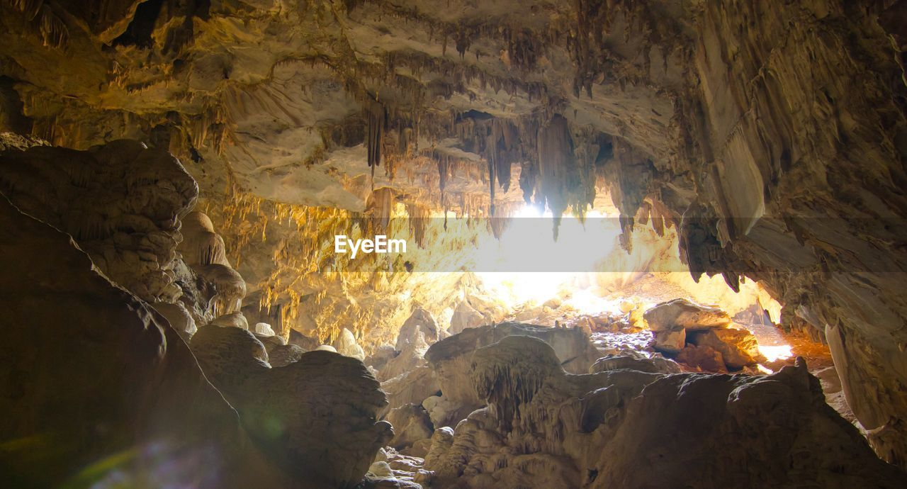 cave, stalactite, nature, rock, no people, geology, rock - object, solid, physical geography, indoors, rock formation, illuminated, fire, beauty in nature, burning, flame, natural pattern, fire - natural phenomenon, heat - temperature, bonfire, eroded