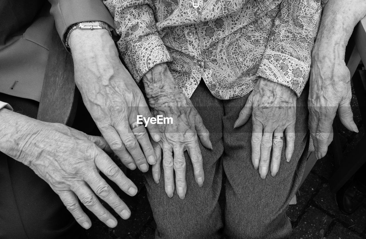 Midsection Of Senior Couple Hands