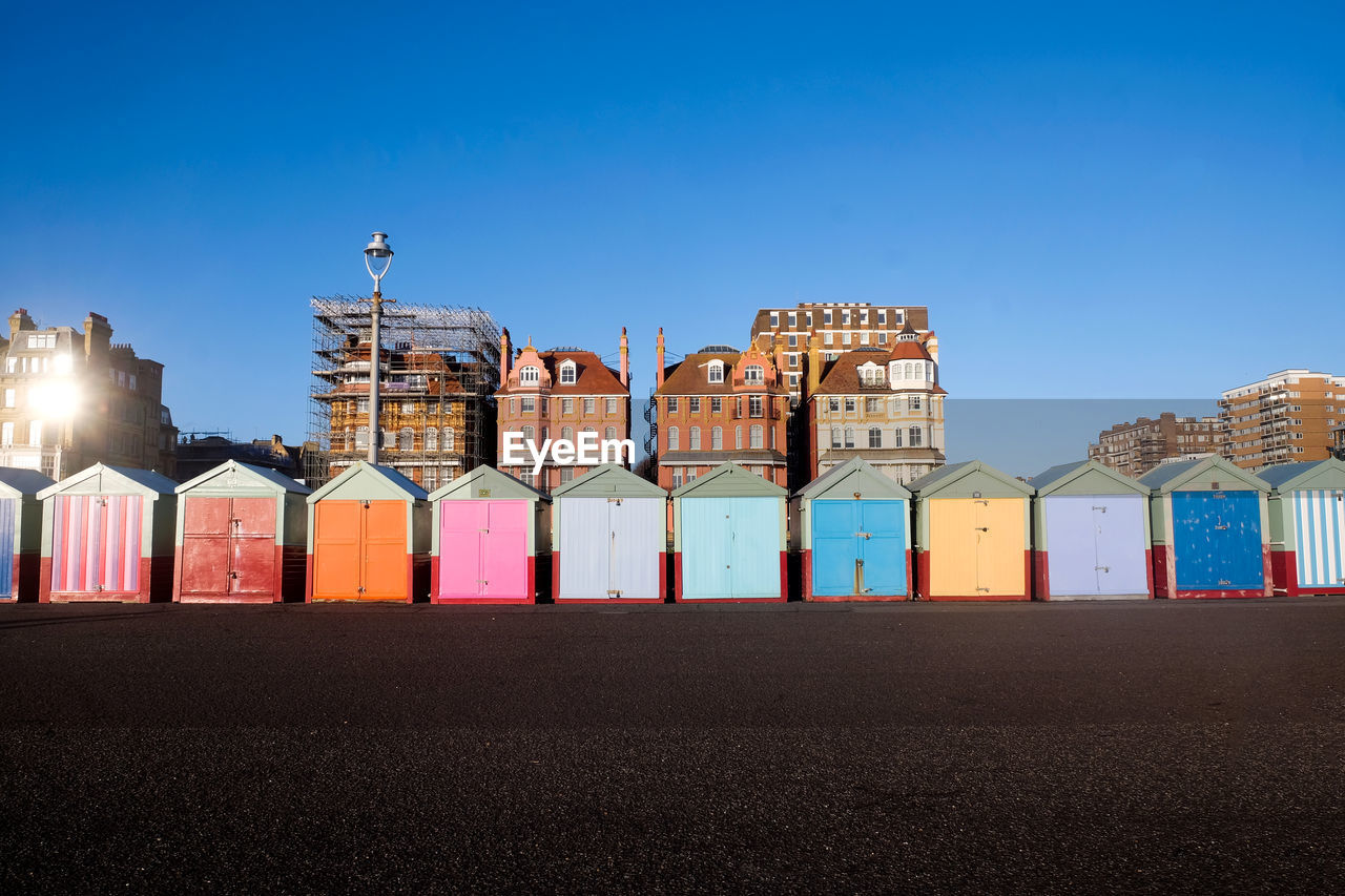 Colorful Huts At Beach Against Blue Sky