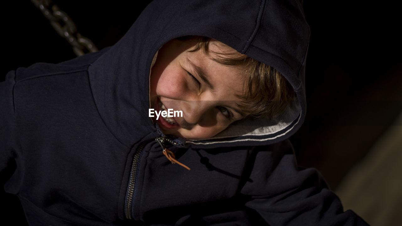 Close-Up Of Boy Winking Eye