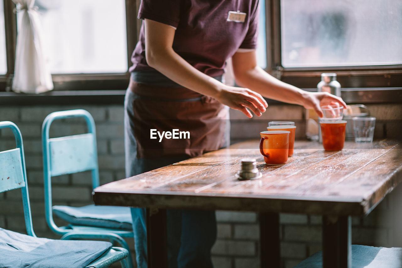 Female Waitress In Restaurant