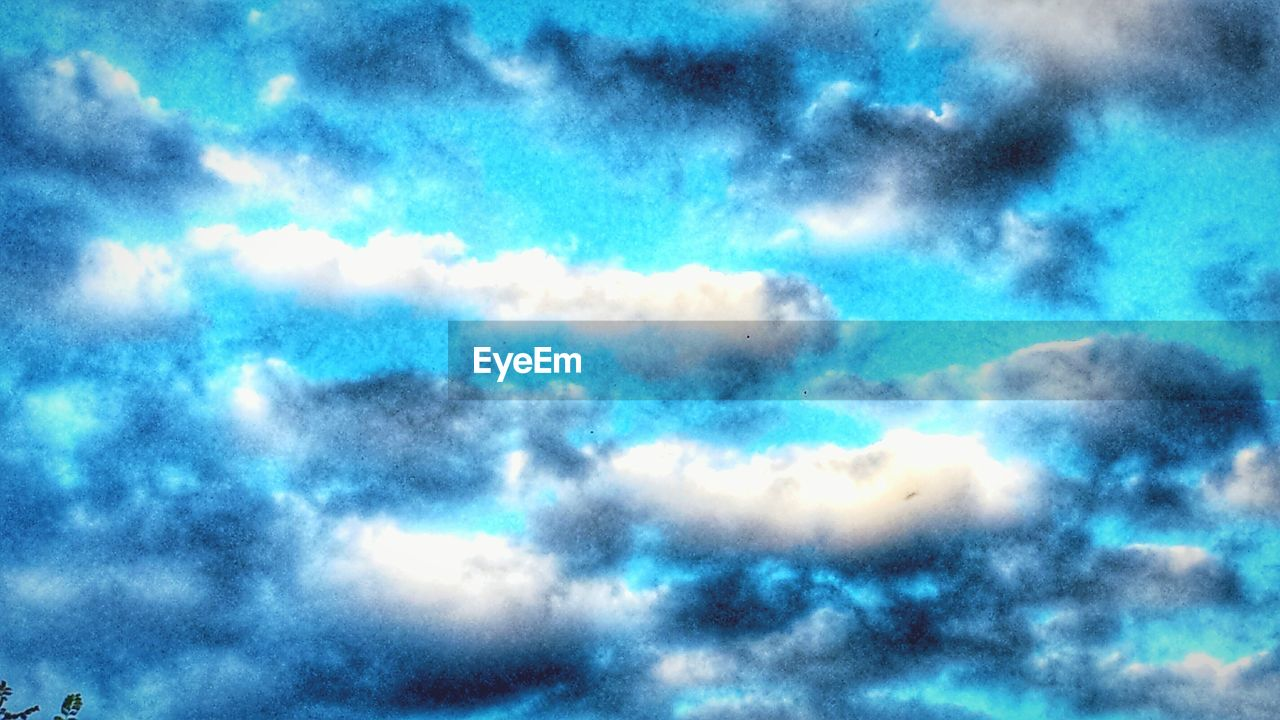 sky, low angle view, cloud - sky, nature, sky only, beauty in nature, full frame, backgrounds, cloudscape, scenics, outdoors, no people, tranquility, abstract, blue, multi colored, day, storm cloud