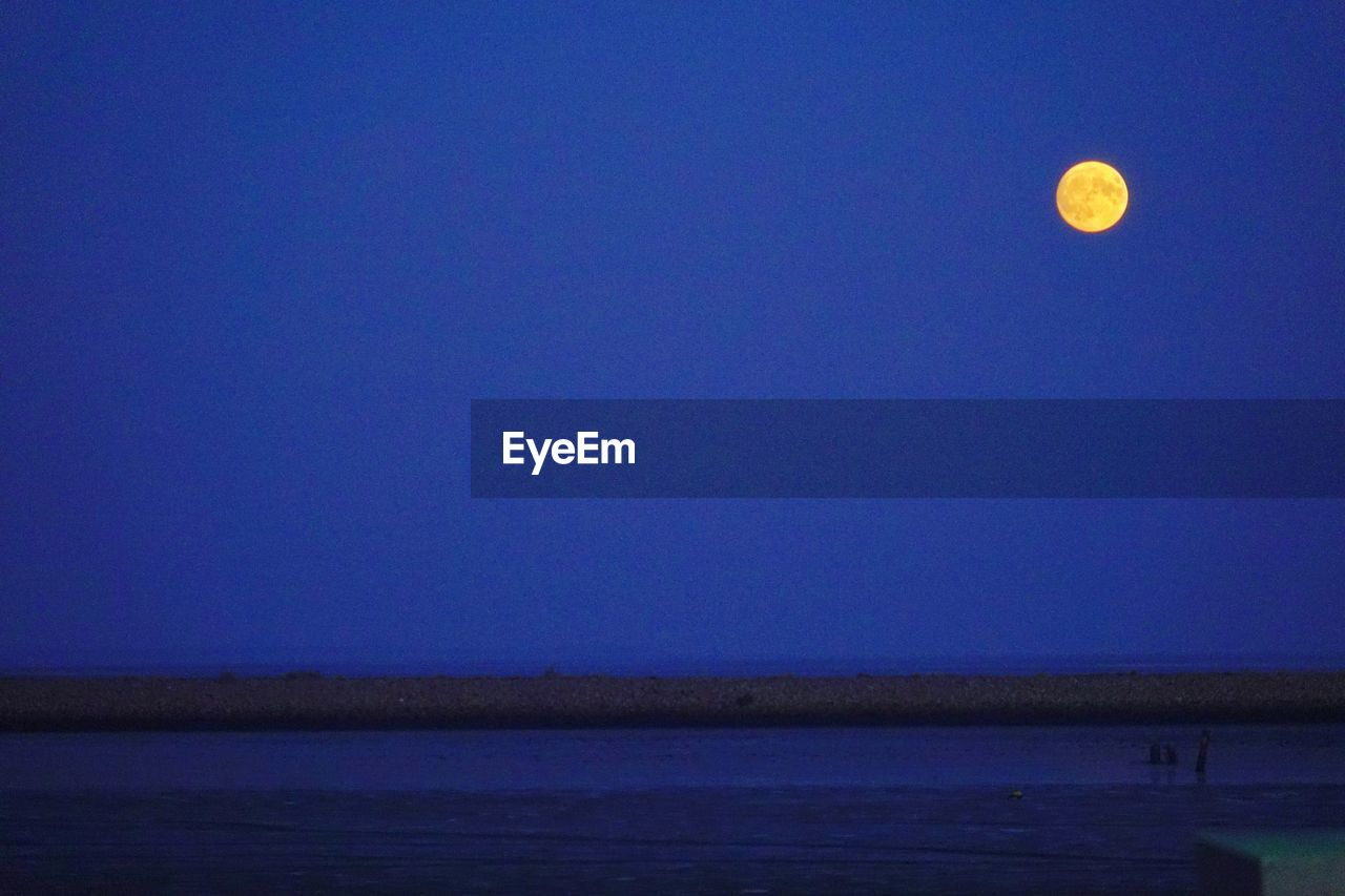 moon, blue, nature, beauty in nature, tranquil scene, tranquility, night, scenics, copy space, clear sky, outdoors, no people, half moon, water, sea, astronomy, landscape, sky
