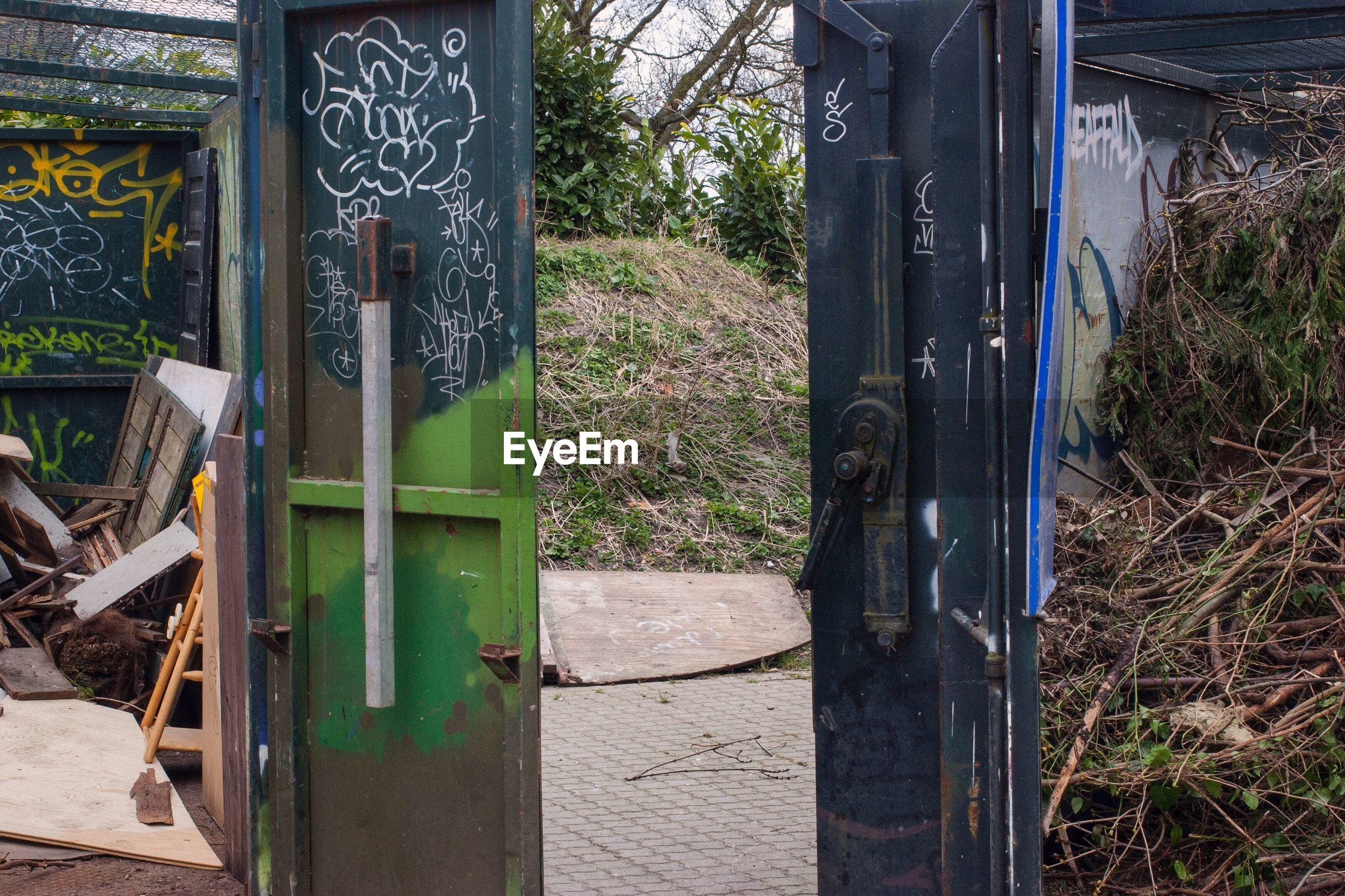 GRAFFITI ON CLOSED DOOR OF METAL GATE