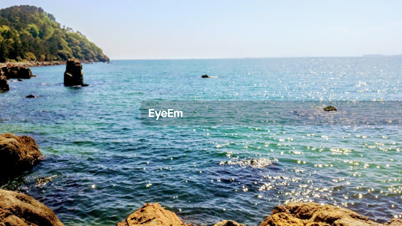 sea, water, nature, beauty in nature, horizon over water, scenics, rock - object, clear sky, outdoors, day, sky, no people