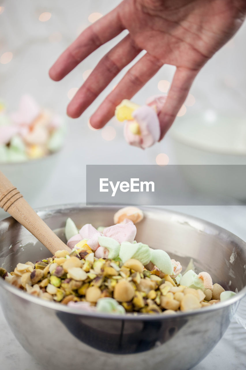 food, food and drink, human hand, hand, freshness, one person, human body part, real people, holding, indoors, wellbeing, bowl, vegetable, preparation, healthy eating, unrecognizable person, kitchen utensil, preparing food, focus on foreground, human limb, finger