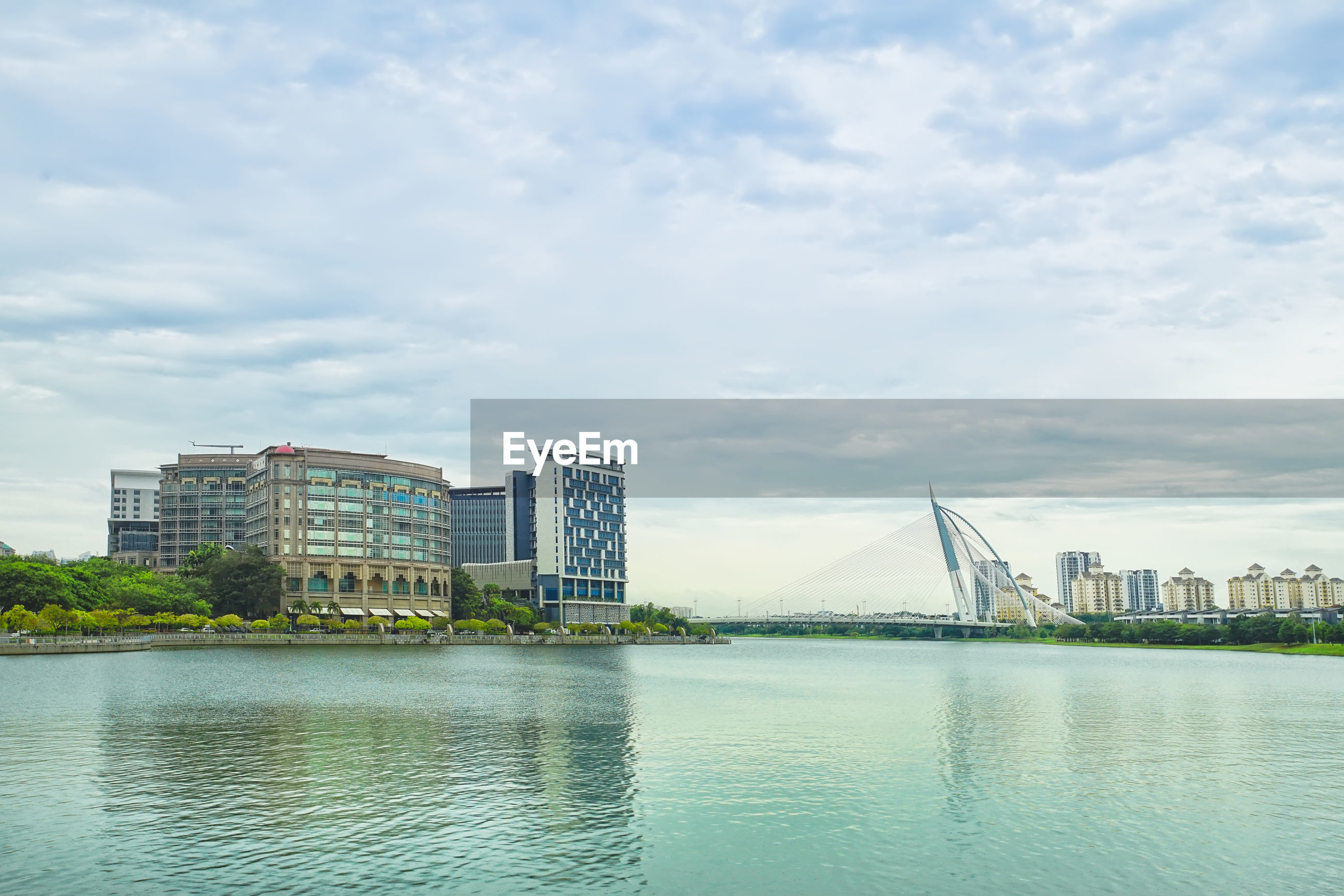 RIVER AND BUILDINGS AGAINST SKY