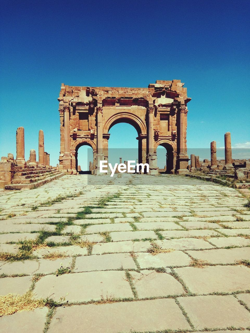 architecture, history, built structure, the past, sky, clear sky, arch, blue, the way forward, day, nature, ancient, direction, travel destinations, no people, building exterior, tourism, travel, sunlight, building, outdoors, ancient civilization, architectural column, ruined, surface level