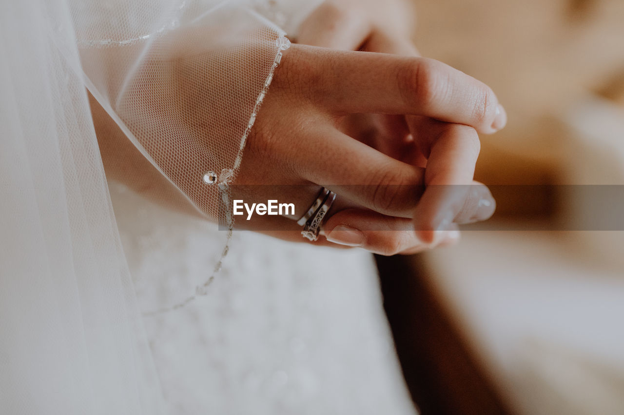 Midsection Of Bride With Hands Clasped