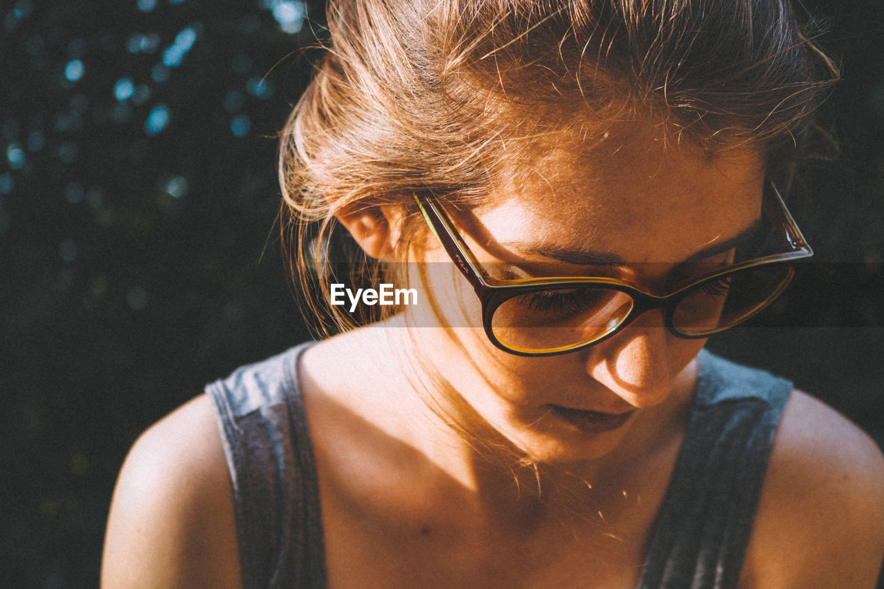 Close-Up Of Young Woman In Eyeglasses
