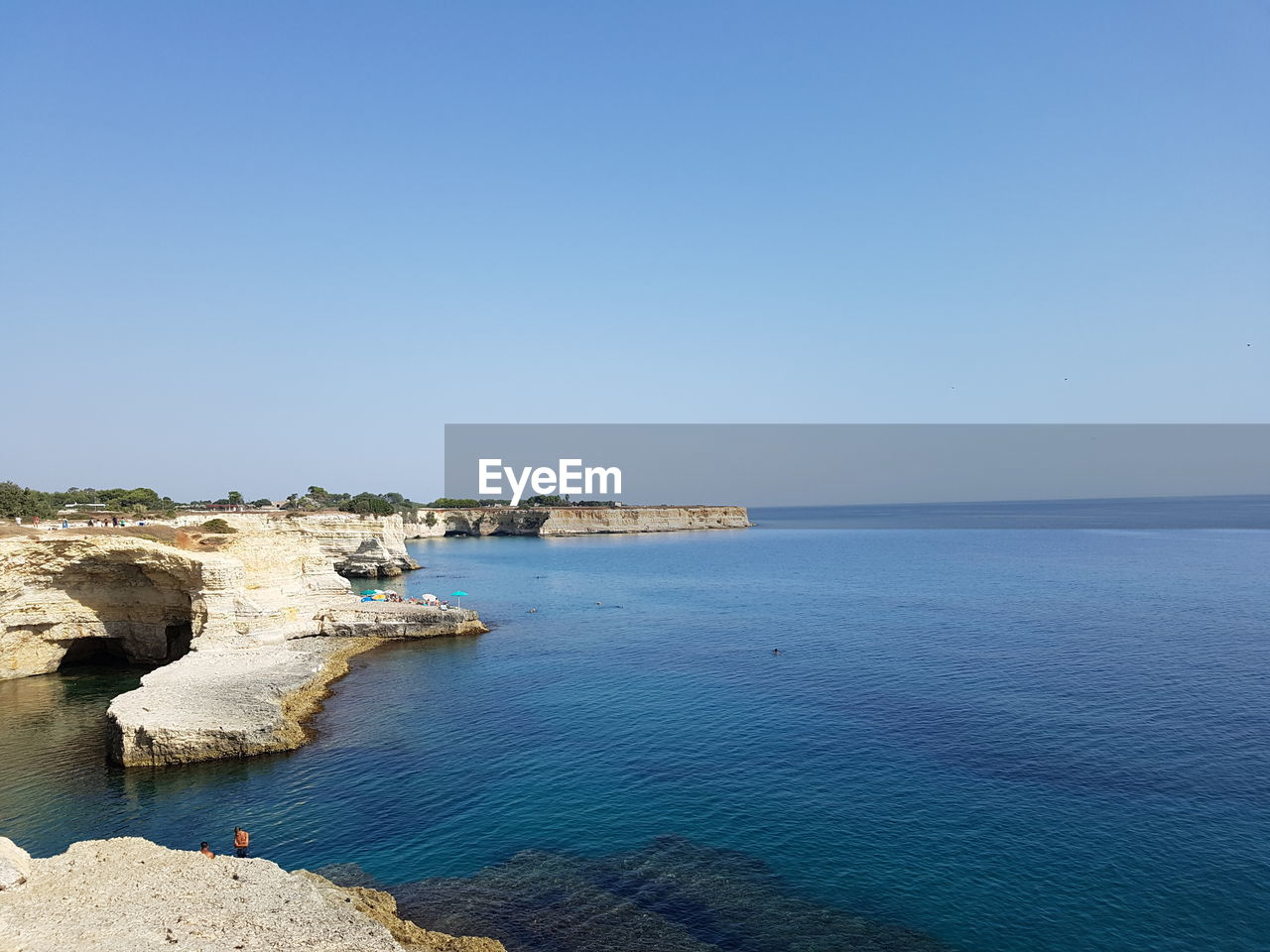water, sea, sky, beauty in nature, scenics - nature, copy space, blue, clear sky, horizon over water, tranquil scene, tranquility, nature, idyllic, land, horizon, day, architecture, cliff, built structure