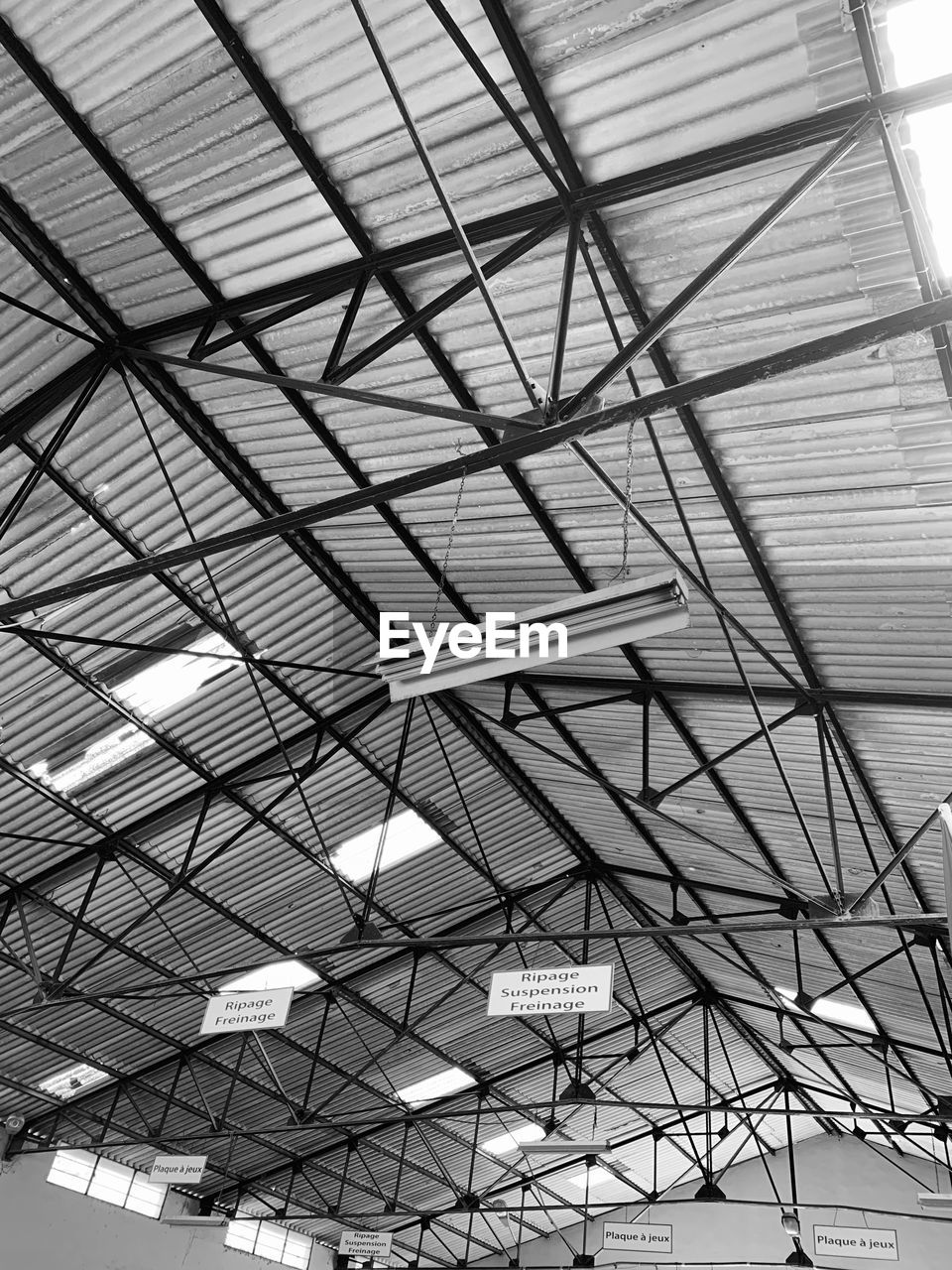 built structure, low angle view, ceiling, architecture, indoors, pattern, no people, day, metal, full frame, roof, building, lighting equipment, hanging, glass - material, sunlight, design, skylight, modern, roof beam