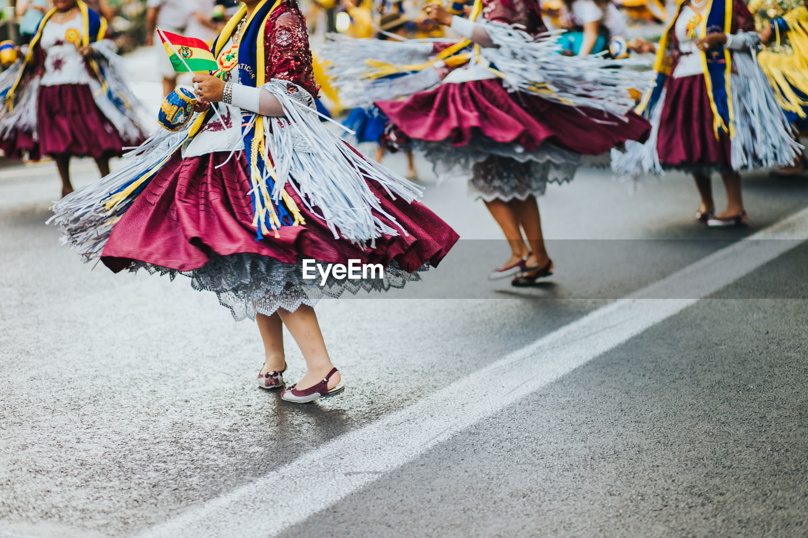 Low section of women dancing on street in city