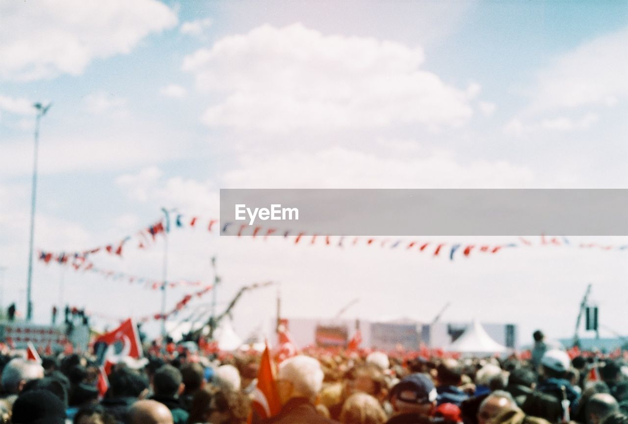 crowd, cloud - sky, sky, group of people, large group of people, real people, nature, flag, day, men, outdoors, women, architecture, watching, red, spectator, togetherness, sport, patriotism
