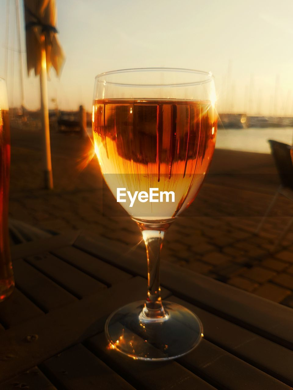 sunset, drink, orange color, alcohol, close-up, wineglass, no people, wine, drinking glass, food and drink, focus on foreground, refreshment, sky, outdoors, day, freshness