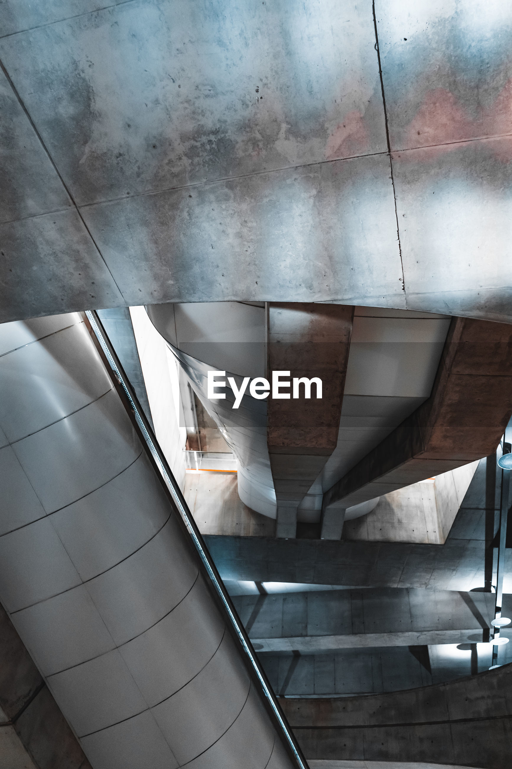 HIGH ANGLE VIEW OF ESCALATOR AND BUILDING