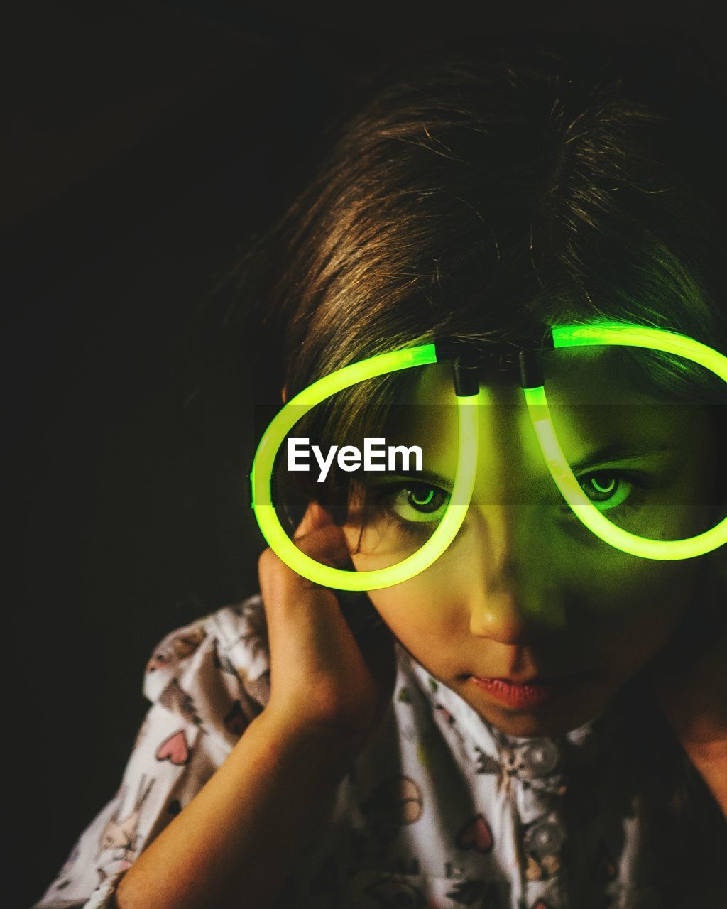 Close-Up Portrait Of Girl Wearing Illuminated Glasses